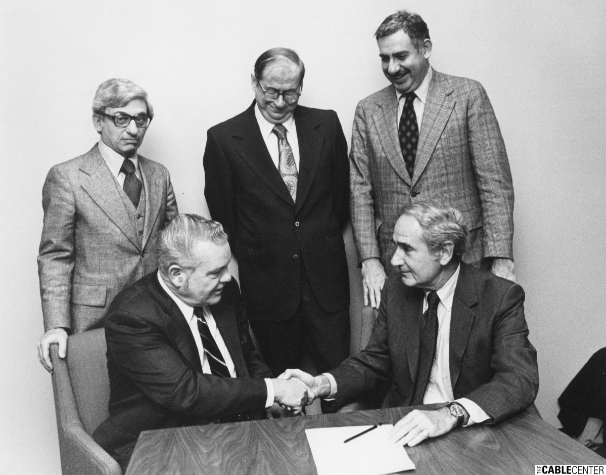 Comcast founders sign deal, 1970s.