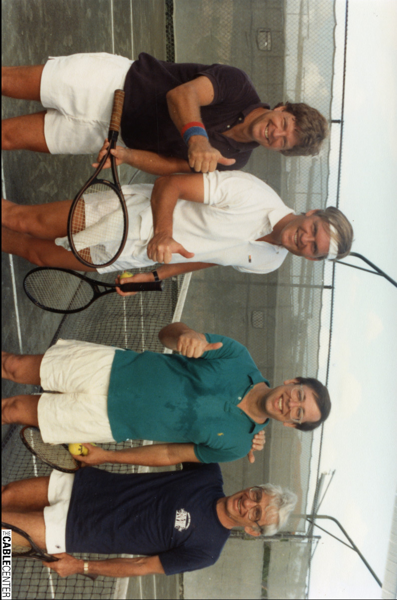 Larry Carlson, Marc Nathanson, and Dan Aaron on tennis court