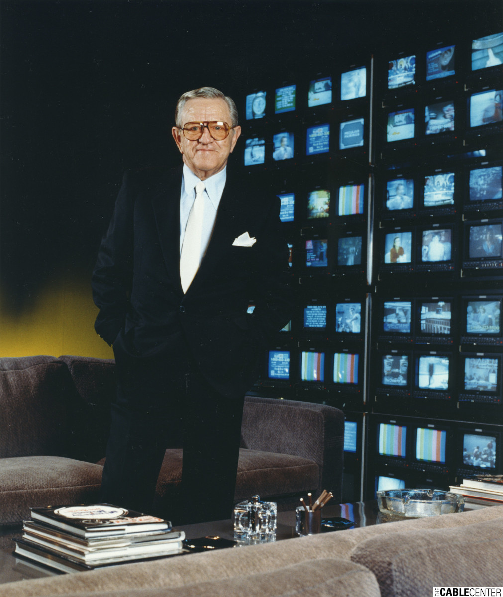 Bill Daniels in front of his wall of televisions