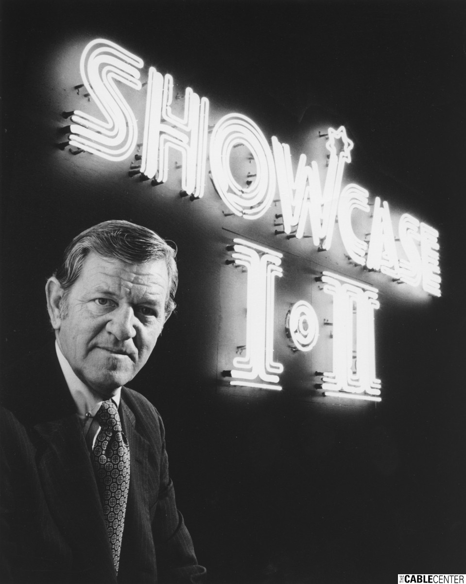 Bill Daniels in front of Showcase I and II neon sign
