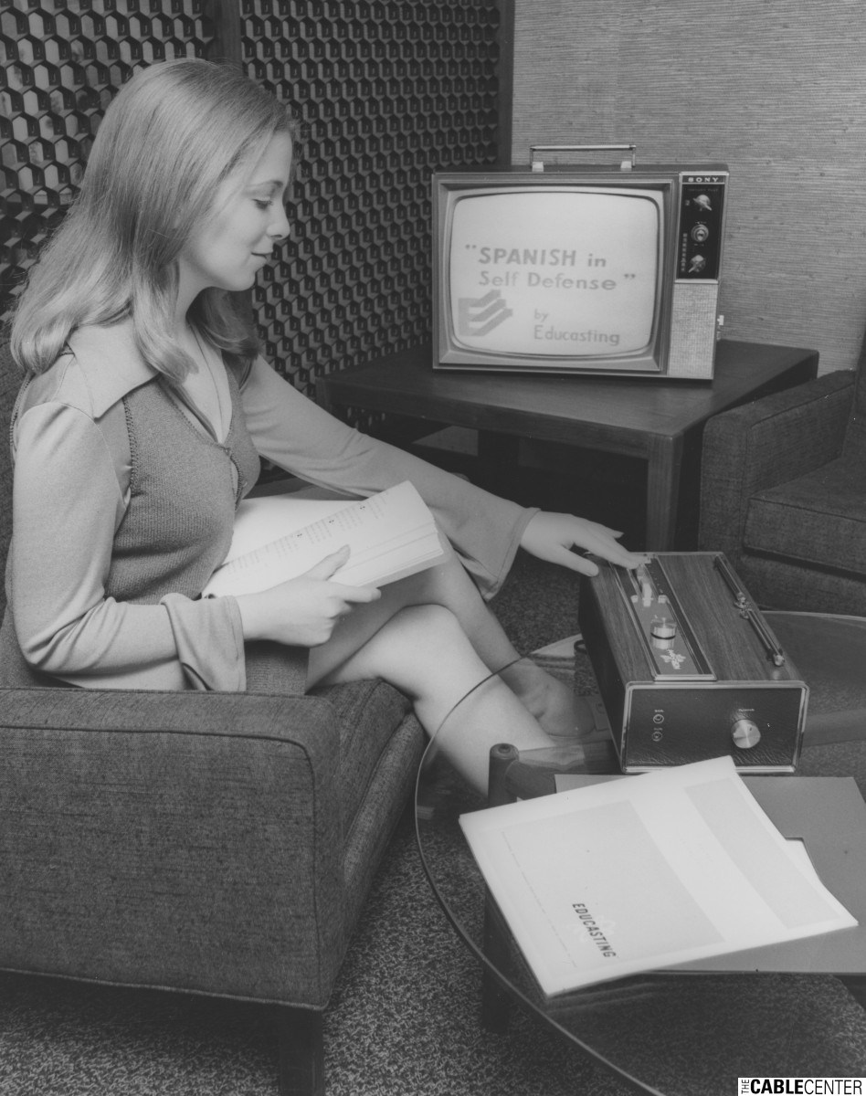 Woman using videocassette player