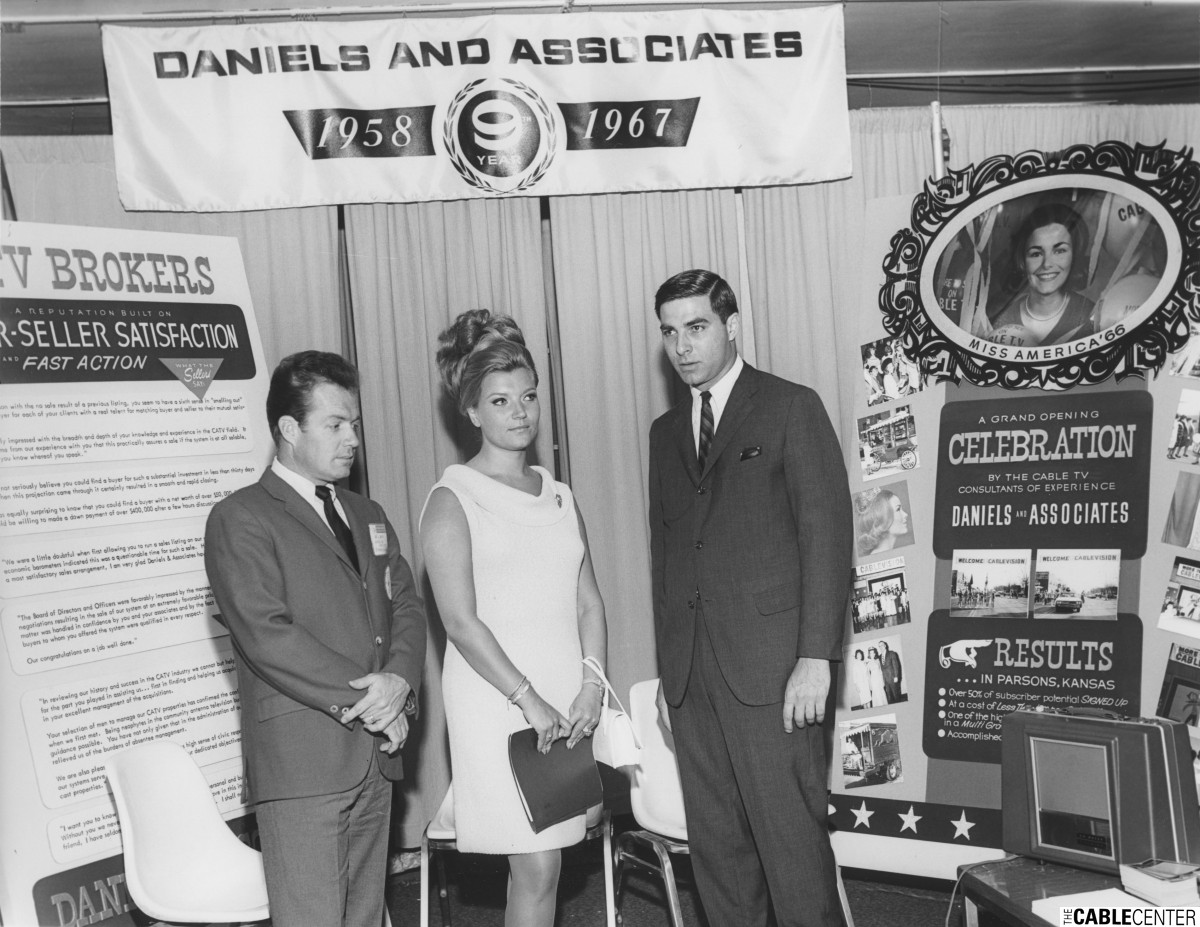 Joe Berry and Frank Scarpa at Daniels & Associates booth