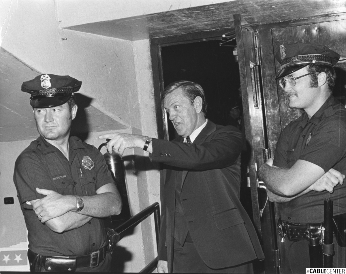 Bill Daniels visiting a jail escorted by two police oficers during his campaign running for Governor of Colorado