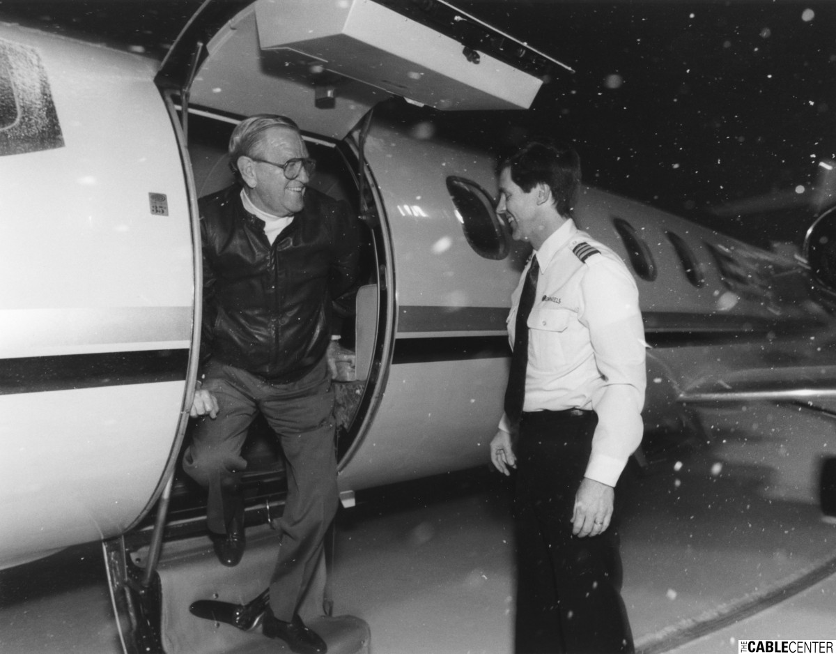 Bill Daniels exits his jet after being the first private aircraft to land at Denver International Airport, Feb. 28, 1995.