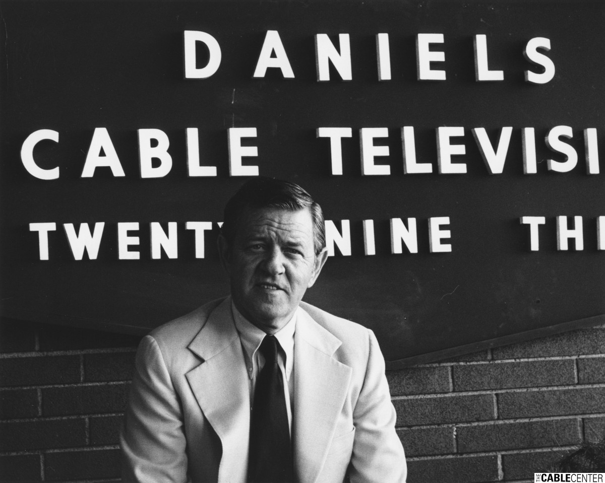 Bill Daniels in front of Daniels & Associates offices, Denver, Colo.