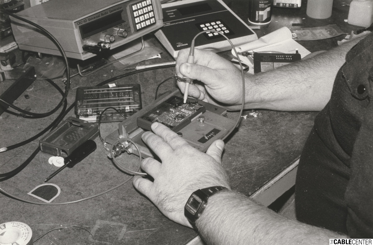 Cable television equipment repair at test bench