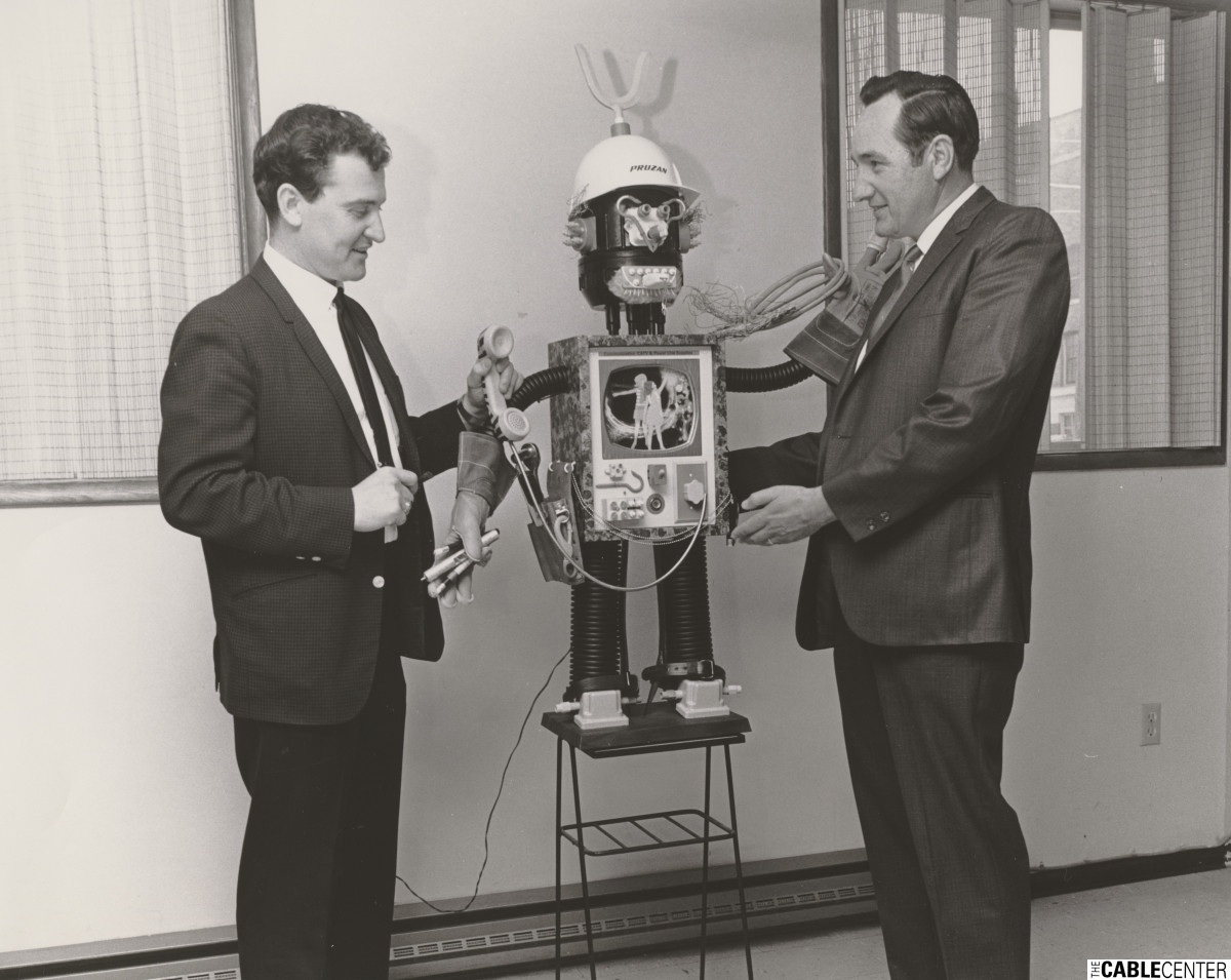 Lloyd Hannah and Al Williams pose with the Pruzan robot