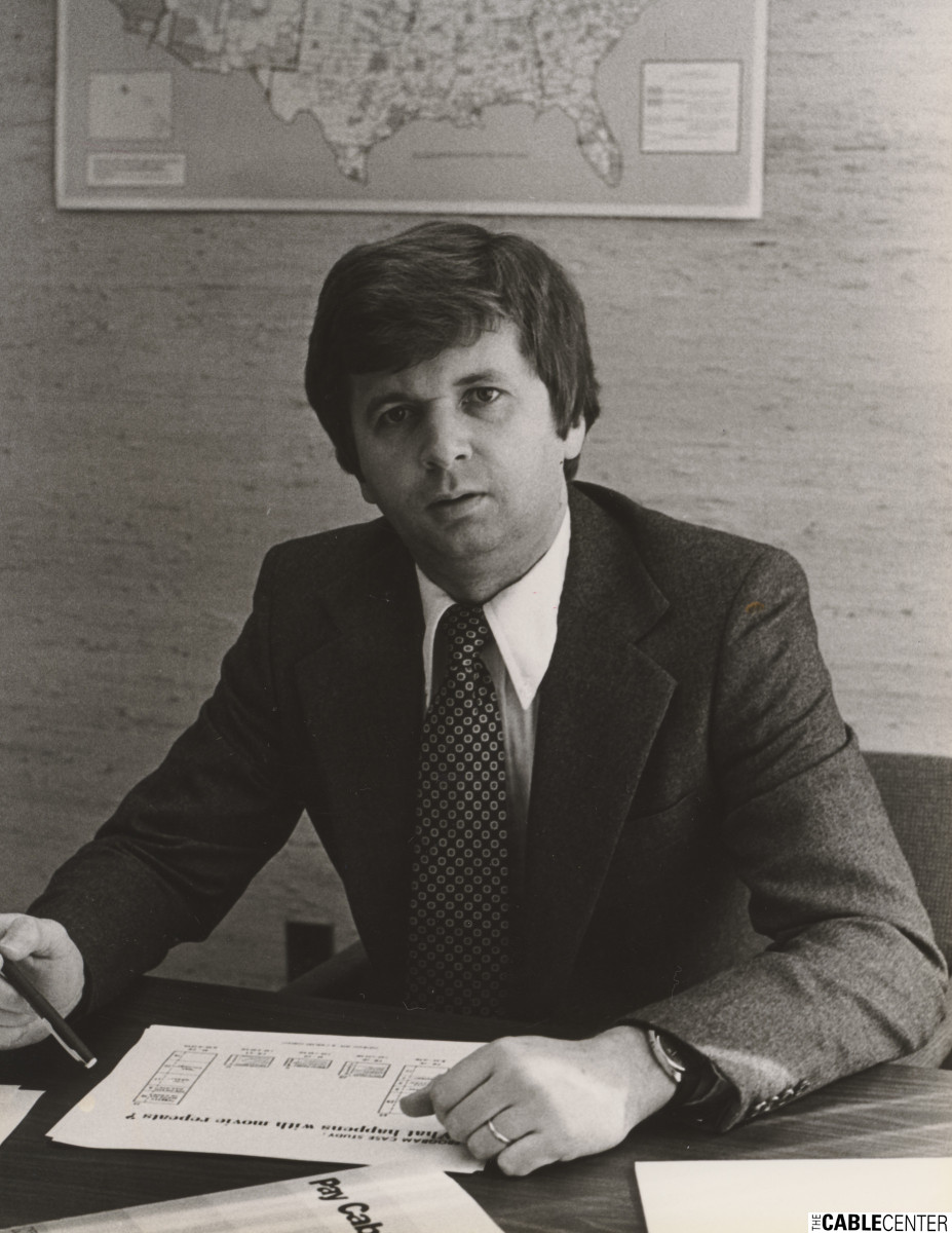 David Harkness seated at desk