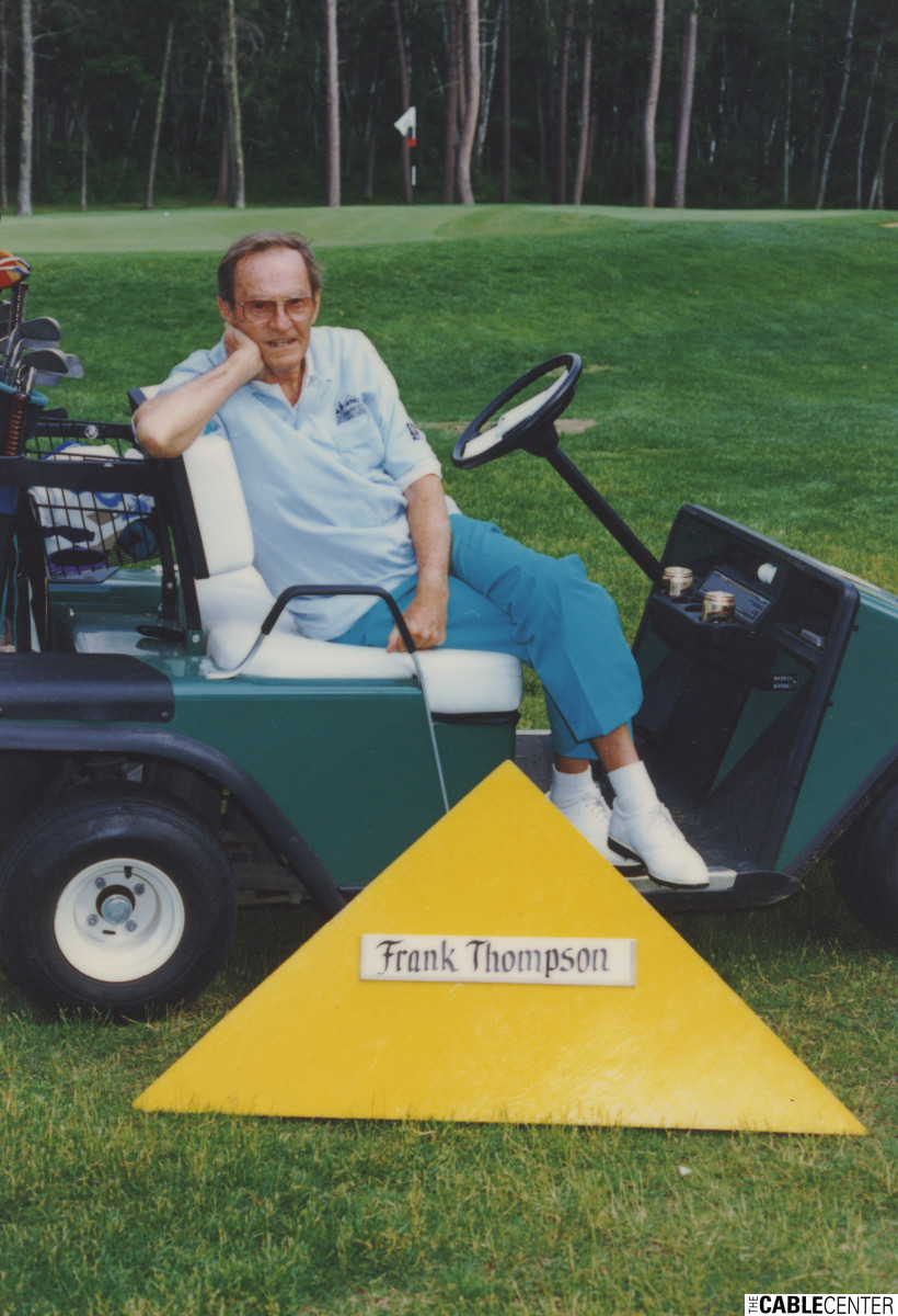 Frank Thompson in a golf cart