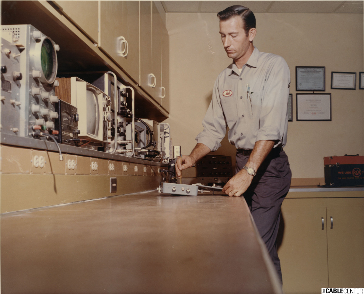 Technician working at test bench