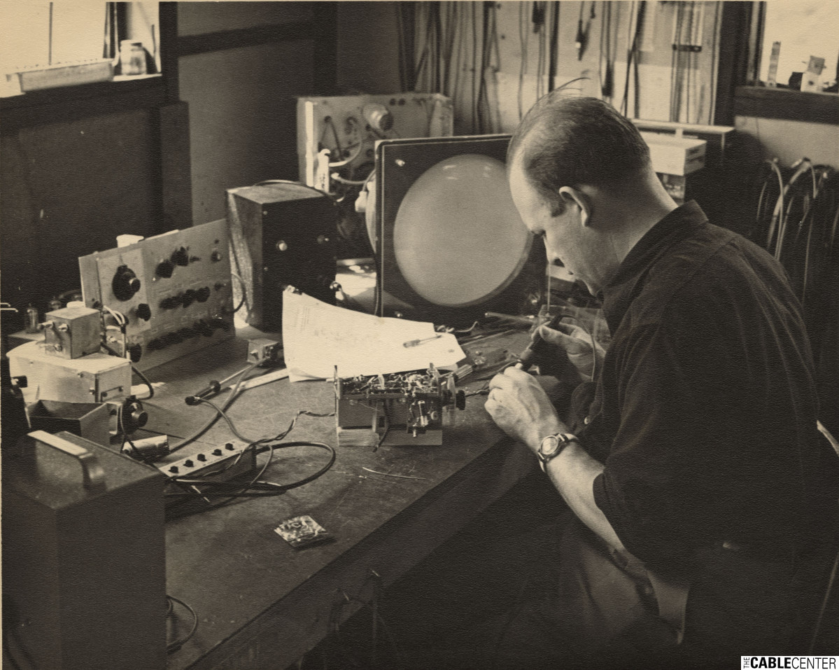Ken Simons at test bench in his laboratory