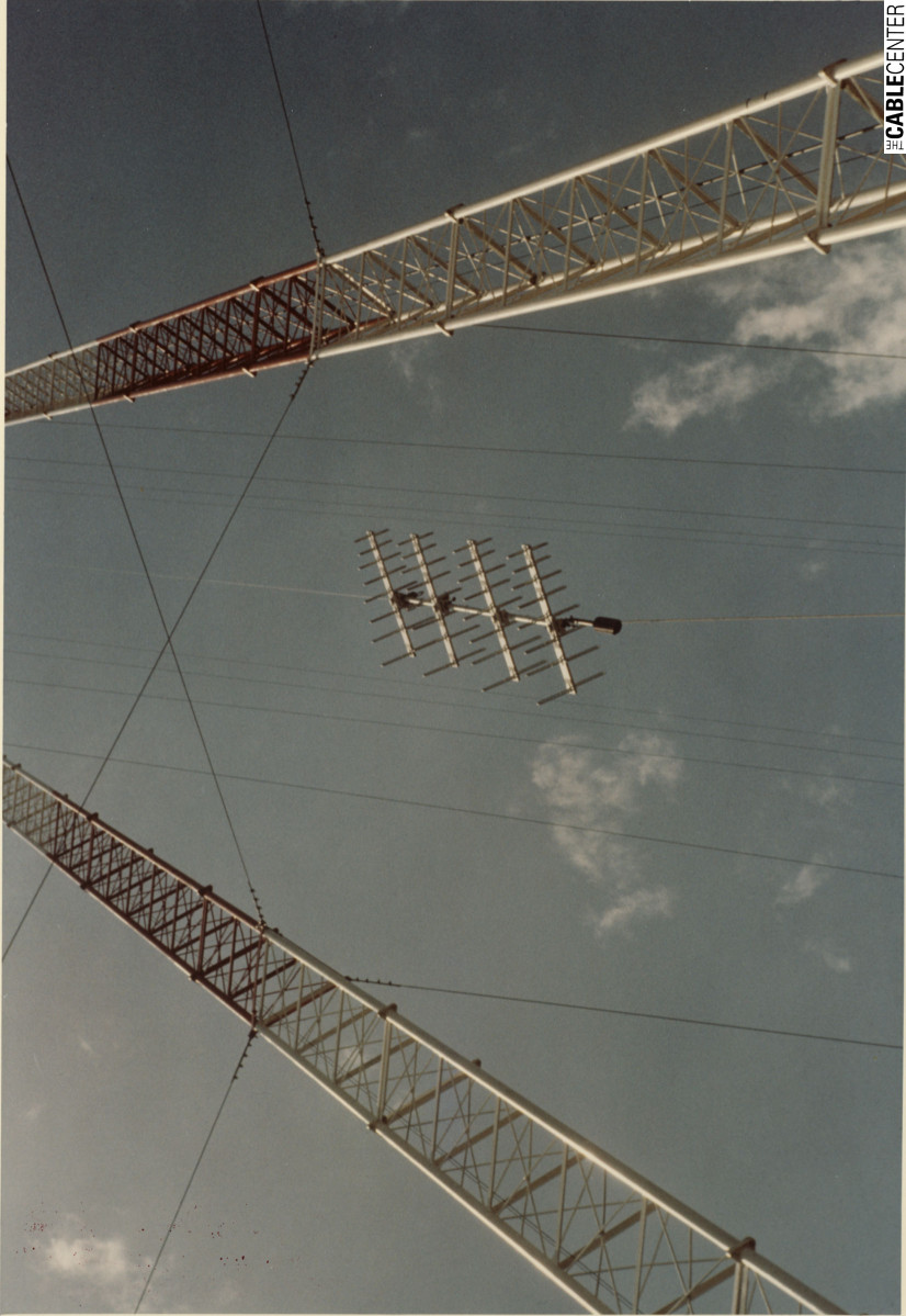 Antenna array being hoisted to top of antenna tower