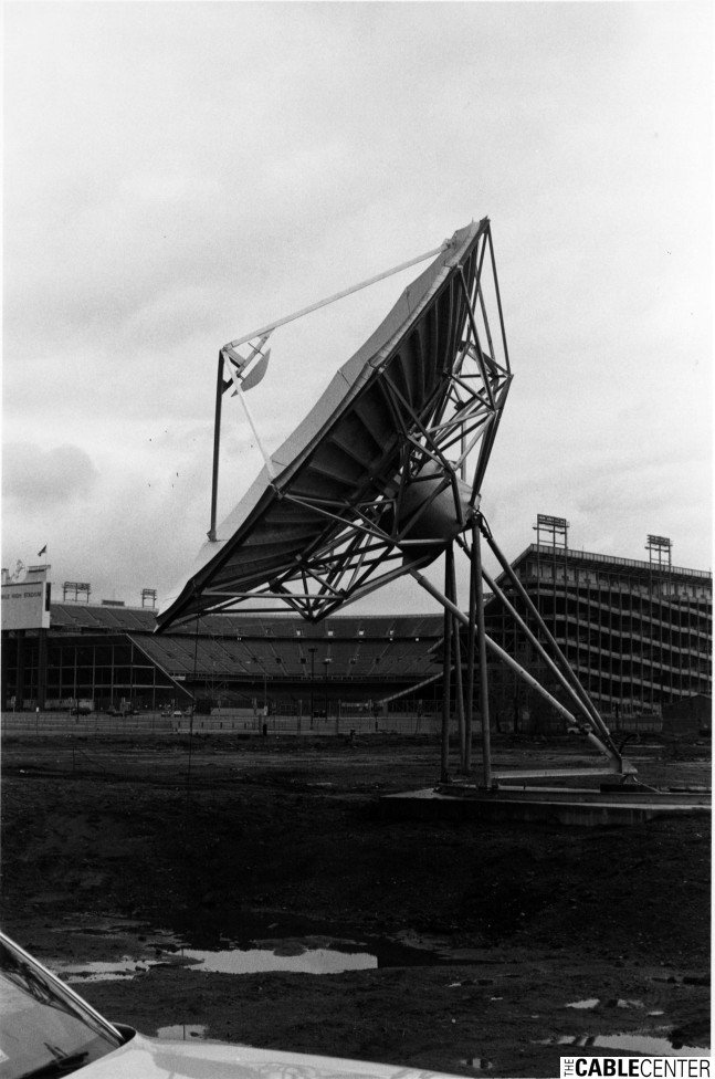 Satellite dish in front of Mile High Stadium, Denver