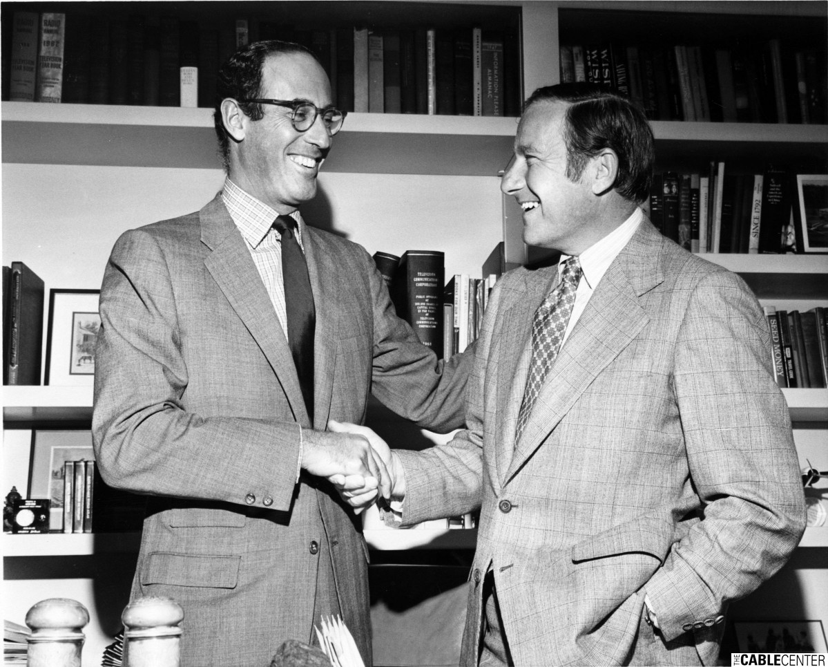 Alfred R. Stern and Burt Harris shaking hands