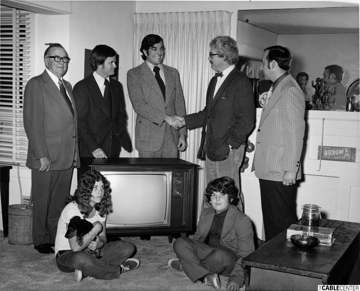 Robert Speier, Sammons Communications' 200,000th subscriber, receives gift of color television