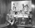 Bill Daniels with sports trophies