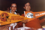 Jane and Marc Nathanson with football team pennants