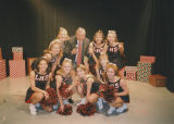 Les Read posing on set with Luther High School Cheerleaders in Oklahoma City, Oklahoma.