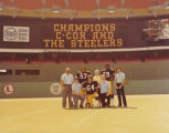 C-Cor Electronics, Inc. staff with three Pittsburgh Steelers football players at Three Rivers Stadium
