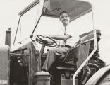 Ted Baum of Viking Industries in cab of tractor