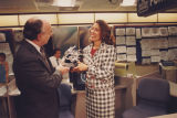 Marilyn Quayle, wife vice president, accepts an award from Michael J. Eckert, President, The Weather