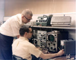 Engineers at C-COR test bench