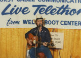 Guitarist on the set of a Black Hawk Cable Communications telethon
