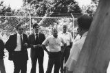 Les Read, Dick Munro, Bob Button, Gerald Levin and others inspecting satellite dish